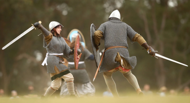 Combatants fight in a Viking re-enactment. Researchers have now shown real Vikings might have been buried with Islamic symbols. Photograph: Mark Kolbe/Getty Images