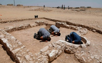 Muslim workers of Israel's antiquities authority pray at the newly discovered remains of an ancient rural mosque, dating back to the era between the 7th and the 8th centuries, in the Israeli Bedouin town of Rahat in the Negev desert on July 18, 2019. AFP