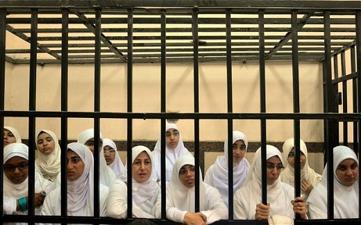 Women supporters of ousted President Mohammed Morsi inside the defendants' cage in a courtroom in Alexandria (FILE) Photo: AP