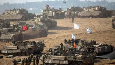 Les chars israéliens déployés près de la frontière de Gaza. | AFP