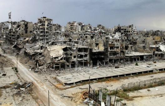 Homs au mois de mai quand un accord négocié par l'Iran a permis aux combattants anti-Assad de la quitter, avec une poignée de non combattants qui ont survécu au siège pendant 2 ans. Photographe : Reuters.