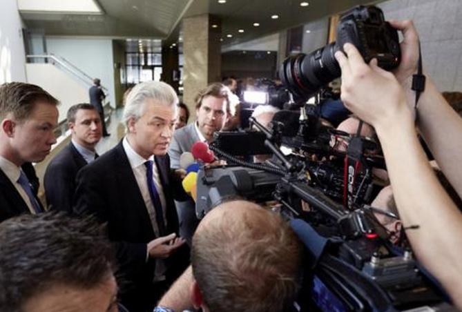 Geert Wilders s'adresse aux médias dans l'enceinte du Parlement à La Haye, aux Pays-bas, mercredi 20 mars 2014 - AFP/ANP/Martijn Beekman